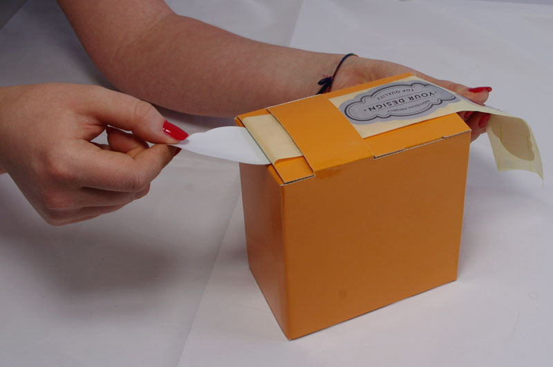 The application of self-adhesive labels